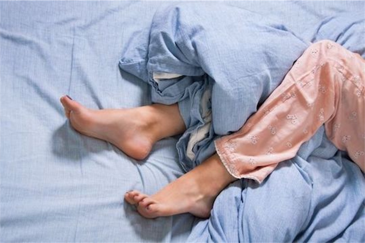 Person in bed with RLS